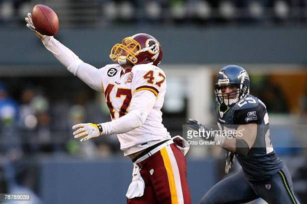 Tight end Chris Cooley of the Washington Redskins makes a one-handed catch in front of Brian Russell of the Seattle Seahawks in the third quarter...