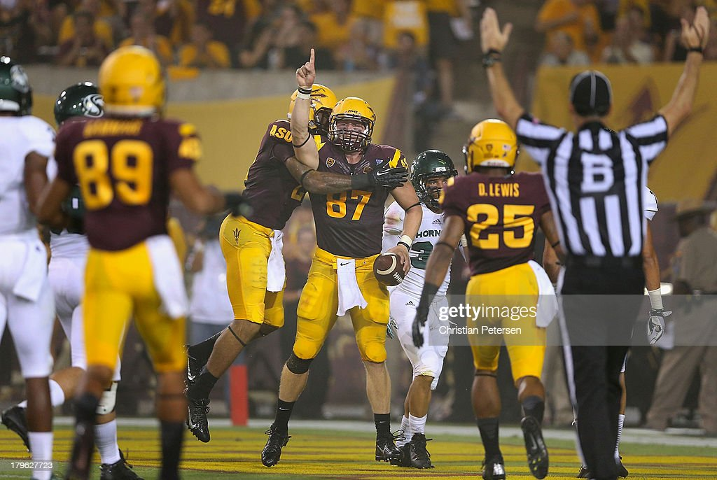 Tight end Chris Coyle #87 of the Arizona State Sun Devils celebrates after scoring a 33 yard touchdown reception against the Sacramento State Hornets during the second quarter of the college football game at Sun Devil Stadium on September 5, 2013 in Tempe, Arizona.