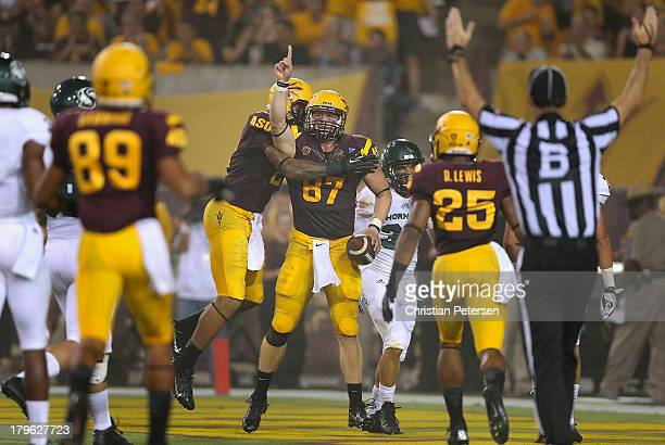 Tight end Chris Coyle of the Arizona State Sun Devils celebrates after scoring a 33 yard touchdown reception against the Sacramento State Hornets...