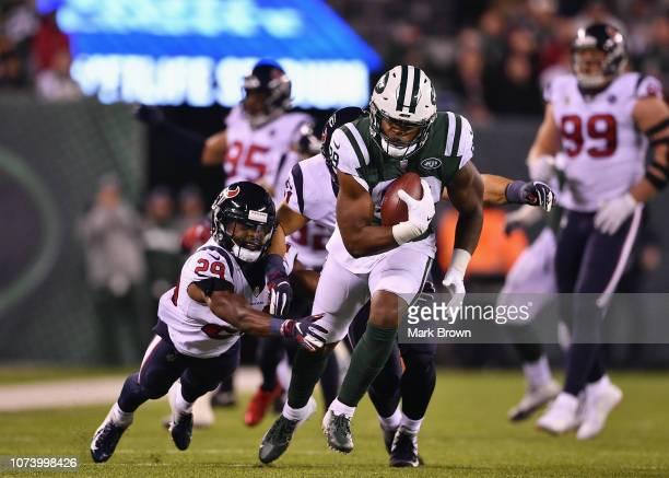Tight end Chris Herndon of the New York Jets is tackled by defensive back Andre Hal of the Houston Texans during the second half at MetLife Stadium...