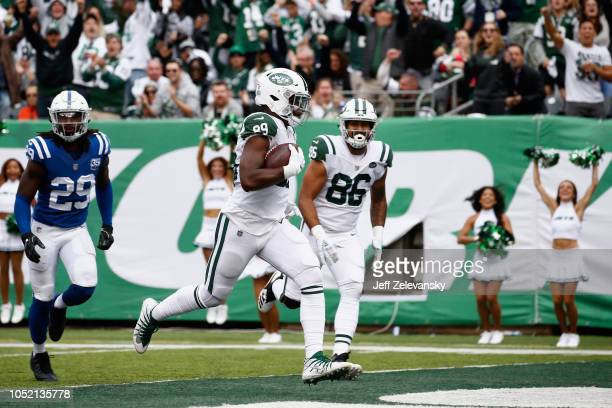 Tight end Chris Herndon of the New York Jets runs in for a touchdown against the Indianapolis Colts during the third quarter at MetLife Stadium on...