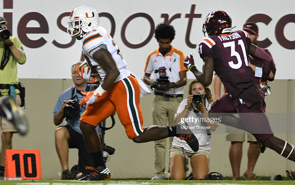 Tight end Christopher Herndon IV #23 of the Miami Hurricanes rushes down the sideline to score a touchdown against the Virginia Tech Hokies in the second half at Lane Stadium on October 20, 2016 in Blacksburg, Virginia. Virginia Tech defeated Miami 37-16.