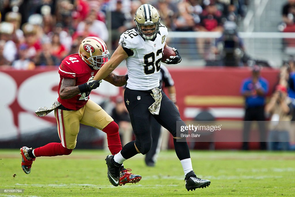 Tight end Coby Fleener #82 of the New Orleans Saints makes a catch against safety Antoine Bethea #41 of the San Francisco 49ers in the second quarter on November, 6 2016 at Levi's Stadium in Santa Clara, California. The Saints won 41-23.