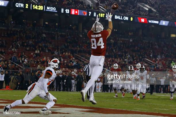Tight end Colby Parkinson of the Stanford Cardinal catches a 5 yard pass for a touchdown in front of safety Jeffrey Manning Jr #15 of the Oregon...