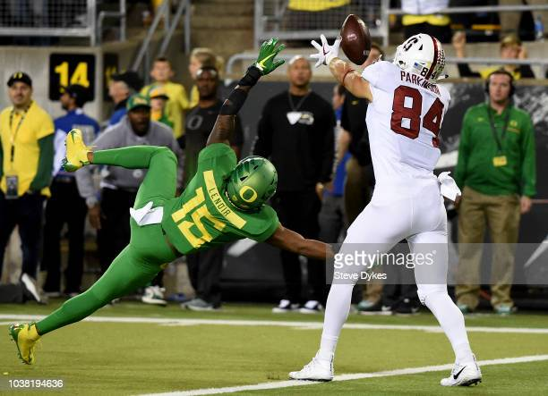 Tight end Colby Parkinson of the Stanford Cardinal catches a touchdown pass over cornerback Deommodore Lenoir of the Oregon Ducks during overtime of...