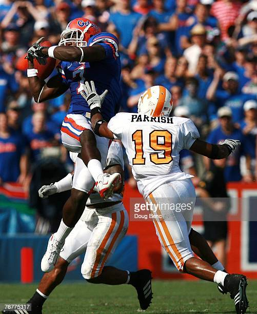 Tight end Cornelius Ingram of the Florida Gators hauls in a reception in the first quarter over defensive back Jarod Parrish of the Tennessee...
