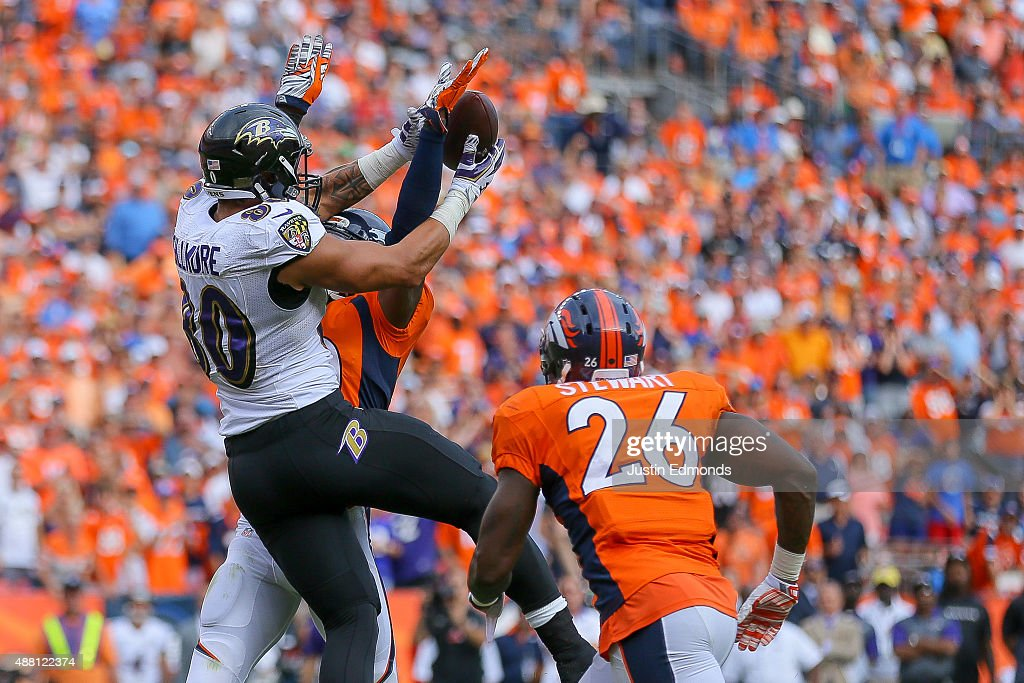 Tight end Crockett Gillmore #80 of the Baltimore Ravens goes up for a catch in the end zone and is defended by strong safety David Bruton #30 and defensive back Darian Stewart #26 of the Denver Broncos, on a play that would result in a game-ending interception by Stewart in the fourth quarter of a game at Sports Authority Field at Mile High on September 13, 2015 in Denver, Colorado.