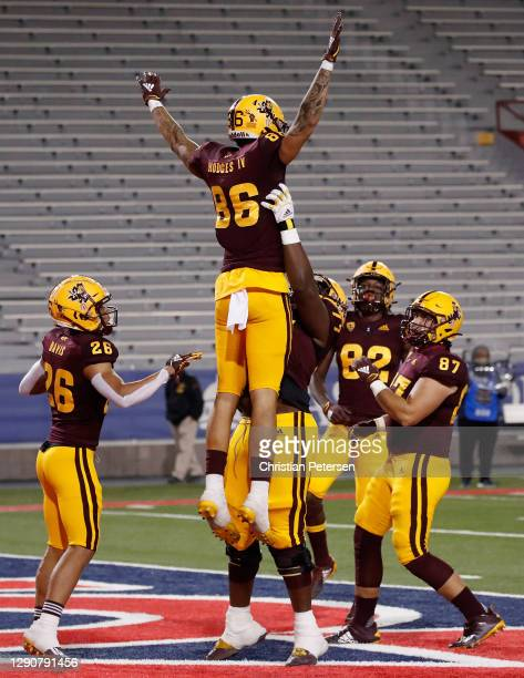 Tight end Curtis Hodges of the Arizona State Sun Devils is lifted in the air after scoring on a 74-yard touchdown reception against the Arizona...