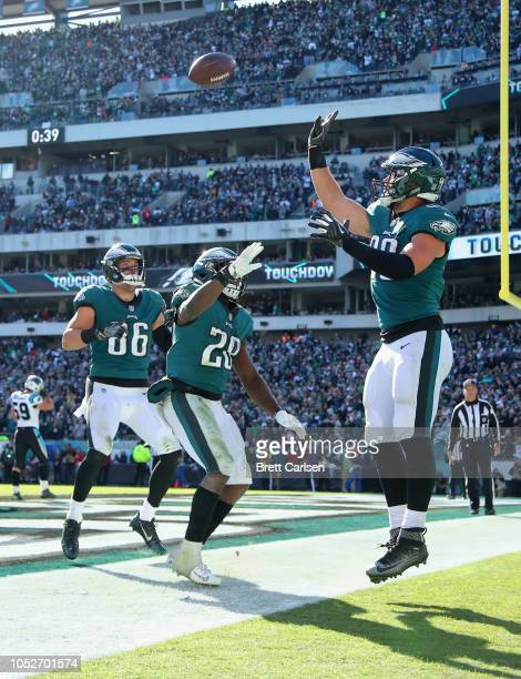 Tight end Dallas Goedert of the Philadelphia Eagles celebrates his touchdown with teammatestight end Zach Ertz and running back Wendell Smallwood...