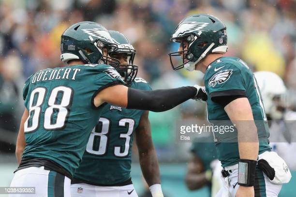 Tight end Dallas Goedert of the Philadelphia Eagles celebrates with teammates tight end Josh Perkins and quarterback Carson Wentz after making a...