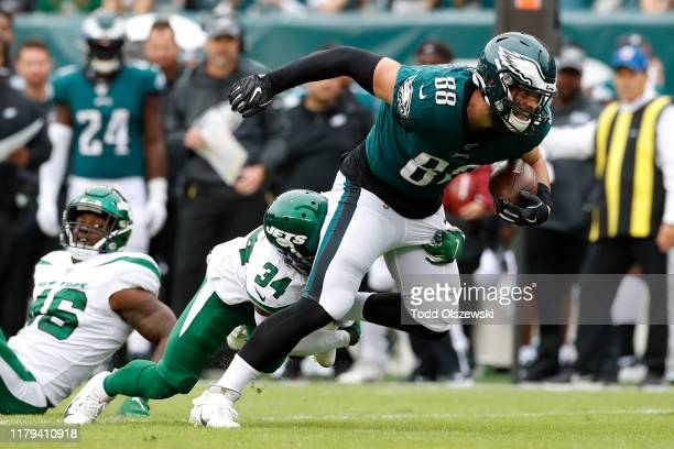 Tight End Dallas Goedert of the Philadelphia Eagles is tackled by cornerback Brian Poole of the New York Jets during the first half at Lincoln...