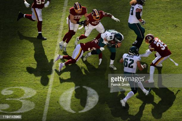 Tight end Dallas Goedert of the Philadelphia Eagles is tackled by cornerback Fabian Moreau of the Washington Redskins during the second quarter at...