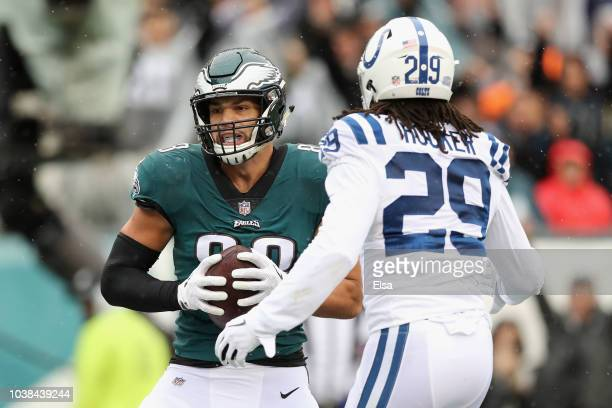 Tight end Dallas Goedert of the Philadelphia Eagles makes a catch for a touchdown against defensive back Malik Hooker of the Indianapolis Colts in...