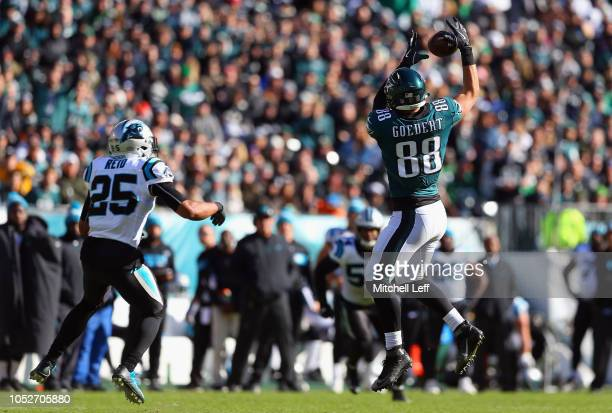 Tight end Dallas Goedert of the Philadelphia Eagles makes a catch against strong safety Eric Reid of the Carolina Panthers during the third quarter...