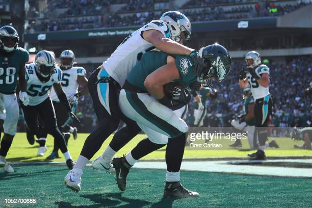 Tight end Dallas Goedert of the Philadelphia Eagles makes a touchdown reception against linebacker David Mayo of the Carolina Panthers during the...
