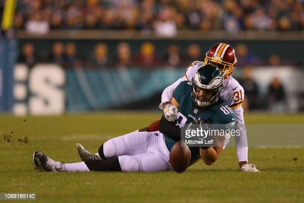 Tight end Dallas Goedert of the Philadelphia Eagles misses a catch against cornerback Fabian Moreau of the Washington Redskins in the first quarter...