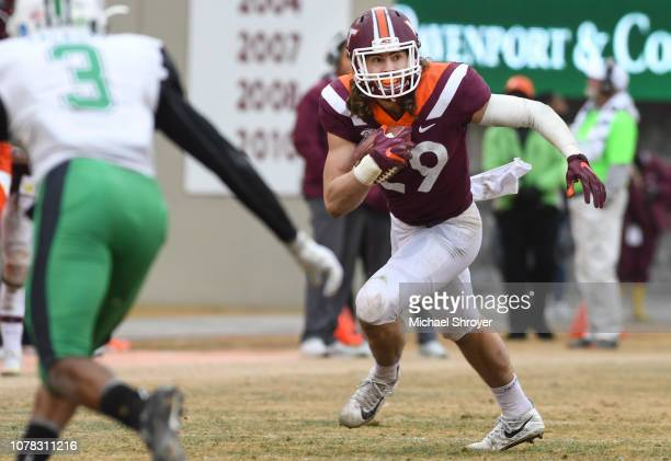 Tight end Dalton Keene of the Virginia Tech Hokies carries the ball following a reception against the Marshall Thundering Herd in the second half at...