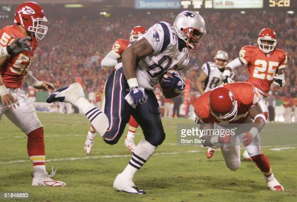 Tight end Daniel Graham of the New England Patriots carries the ball against the Kansas City Chiefs during the game on November 22 2004 at Arrowhead...