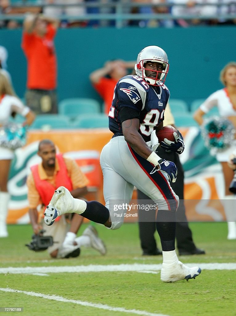 Tight end Daniel Graham #82 of the New England Patriots scores a touchdown that was overturned by officials during the game against the Miami Dolphins at Dolphin Stadium on December 10, 2006 in Miami, Florida. The Dolphins defeated the Patriots 21-0.
