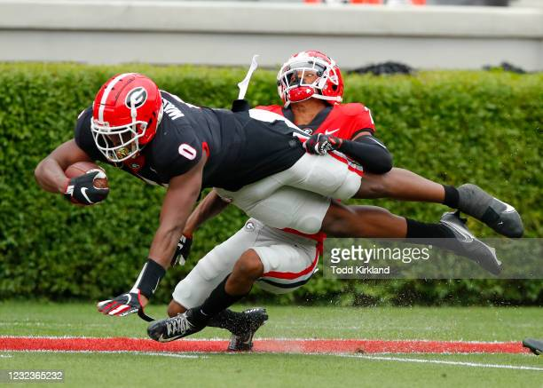 Tight end Darnell Washington of the Georgia Bulldogs dives in for a touchdown as defensive back Javon Bullard defends of the Georgia Bulldogs defends...