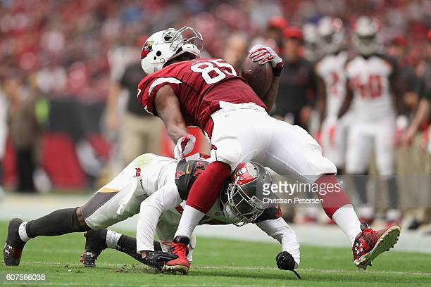 Tight end Darren Fells of the Arizona Cardinals is hit by cornerback Vernon Hargreaves of the Tampa Bay Buccaneers during the second quarter of the...