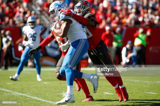 Tight end Darren Fells of the Detroit Lions runs for a first down while getting pressure from middle linebacker Kwon Alexander of the Tampa Bay...