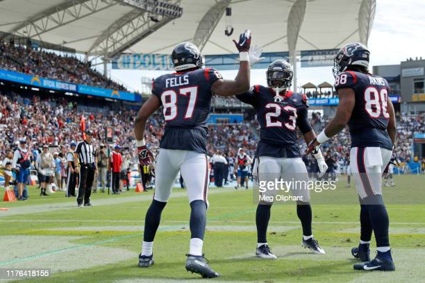 Tight end Darren Fells of the Houston Texans celebrates his touchdown in the second quarter against the Los Angeles Chargers with running back Carlos...