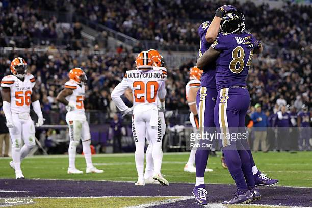 Tight end Darren Waller of the Baltimore Ravens celebrates with teammate fullback Kyle Juszczyk after scoring a third quarter touchdown against the...