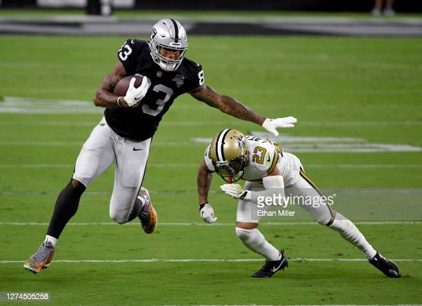 Tight end Darren Waller of the Las Vegas Raiders is tackled by cornerback Marshon Lattimore of the New Orleans Saints during the first half of the...