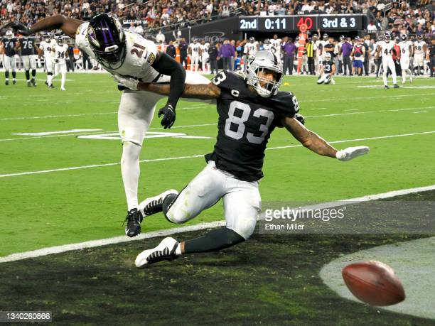 Tight end Darren Waller of the Las Vegas Raiders reaches for an incomplete pass, broken up by cornerback Brandon Stephens of the Baltimore Ravens,...