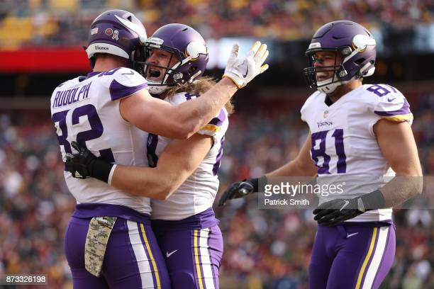 Tight end David Morgan of the Minnesota Vikings celebrates with tight end Kyle Rudolph of the Minnesota Vikings after scoring a touchdown during the...