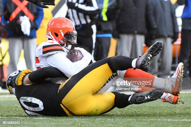 Tight end David Njoku of the Cleveland Browns is tackled by linebacker TJ Watt of the Pittsburgh Steelers in the third quarter of a game on December...