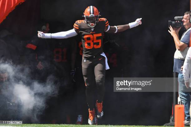 Tight end David Njoku of the Cleveland Browns runs onto the field as he is introduced to the crowd prior to a game against the Tennessee Titans on...