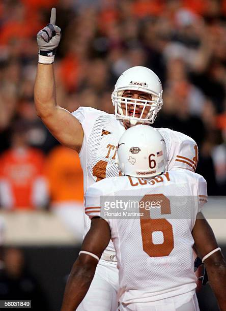 Tight end David Thomas of the Texas Longhorns celebrates a touchdown with teammate Quan Cosby against the Oklahoma State Cowboys October 29 2005 at...