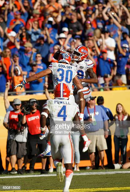 Tight end DeAndre Goolsby of the Florida Gators celebrates his touchdown with teammate wide receiver Tyrie Cleveland during the third quarter of the...