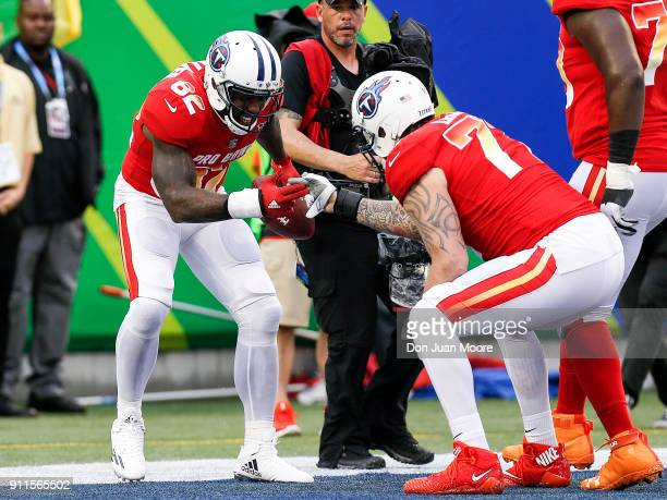 Tight end Delanie Walker and tackle Taylor Lewan both of the Tennessee Titans from the AFC Team celebrate a touchdown by Walker during the NFL Pro...