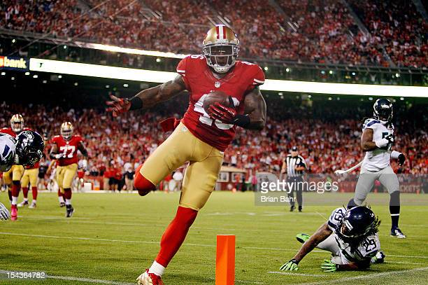 Tight end Delanie Walker of the San Francisco 49ers scores a touchdown on a catch and run against free safety Earl Thomas of the Seattle Seahawks in...