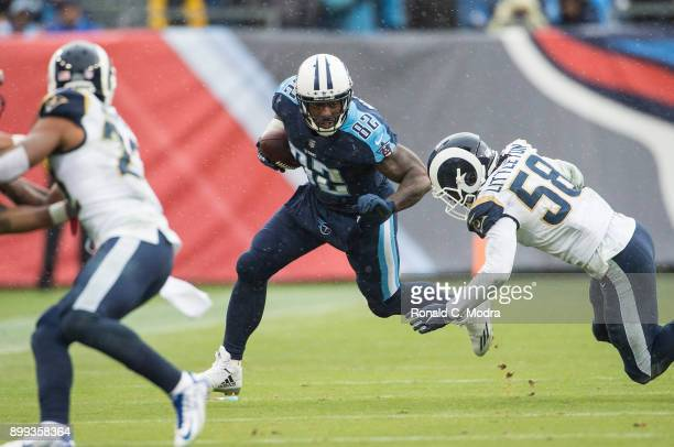 Tight end Delanie Walker of the Tennessee Titans carries the ball during a NFL game against the Los Angeles Rams at Nissan Stadium on December 24...