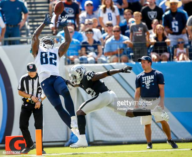 Tight end Delanie Walker of the Tennessee Titans catches the ball against safety Karl Joseph of the Oakland Raiders in the second half at Nissan...