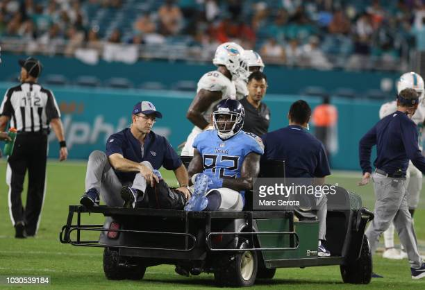 Tight End Delanie Walker of the Tennessee Titans is treated for a severe ankle injury after he is tackled by Safety TJ McDonald of the Miami Dolphins...