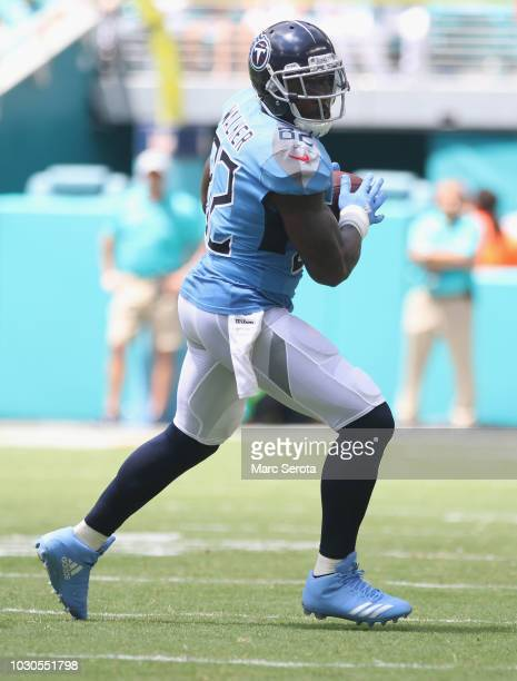 Tight End Delanie Walker of the Tennessee Titans runs after the catch against Jerome Baker of the Miami Dolphins at Hard Rock Stadium on September 9...