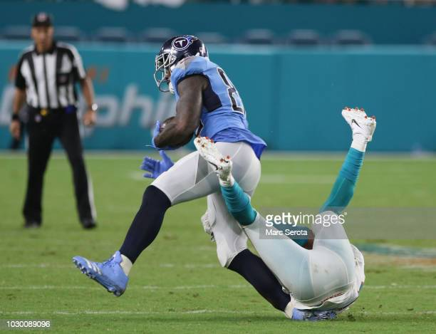Tight End Delanie Walker of the Tennessee Titans suffers a severe ancle injury as he is tackled by Safety TJ McDonald of the Miami Dolphins at Hard...