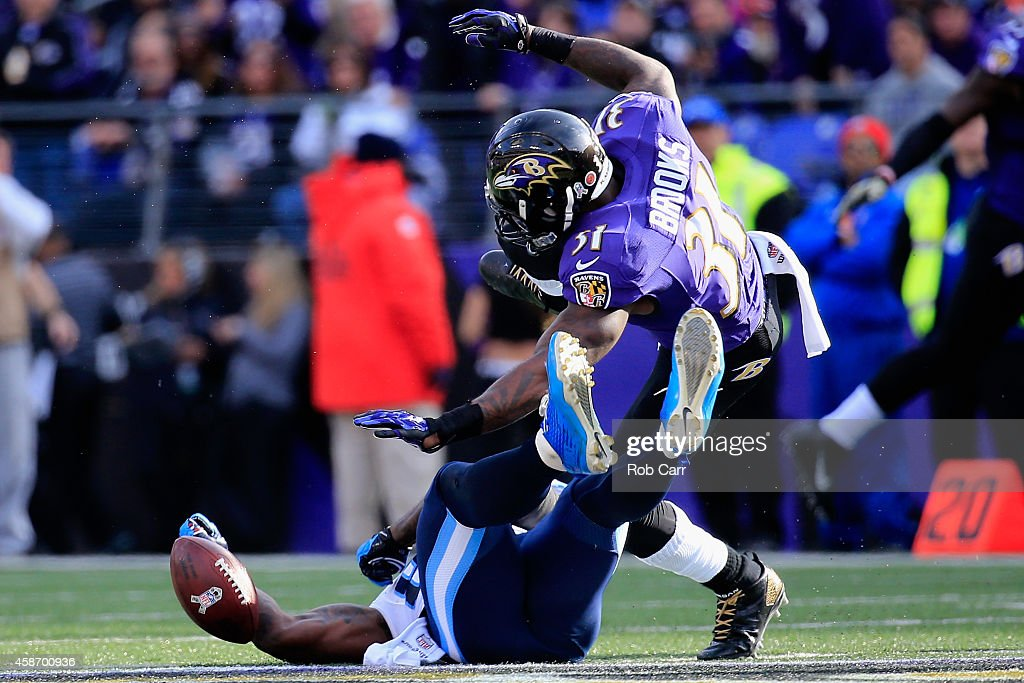 Tight end Delanie Walker #82 of the Tennessee Titans takes a second quarter hit from free safety Terrence Brooks #31 of the Baltimore Ravens at M&T Bank Stadium on November 9, 2014 in Baltimore, Maryland.