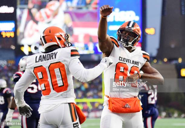 Tight end Demetrius Harris of the Cleveland Browns celebrates with wide receiver Jarvis Landry after scoring a touchdown in the second quarter of the...
