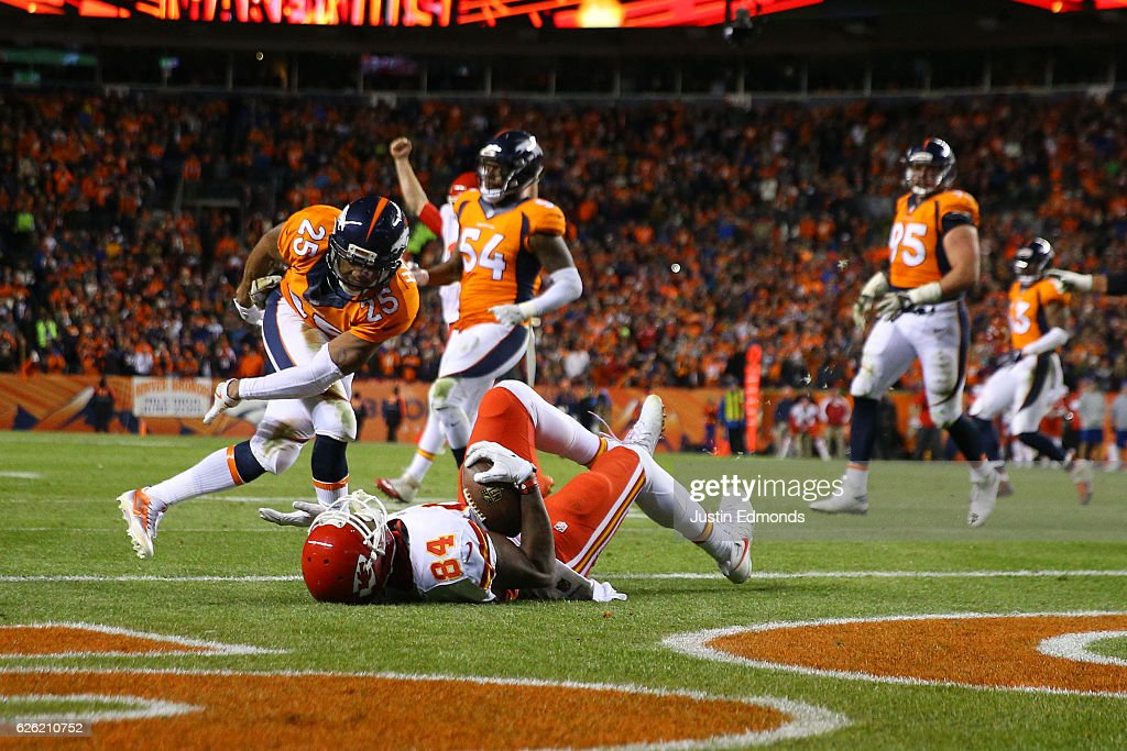 Tight end Demetrius Harris #84 of the Kansas City Chiefs catches a pass for a two point conversion in the fourth quarter at Sports Authority Field at Mile High on November 27, 2016 in Denver, Colorado.