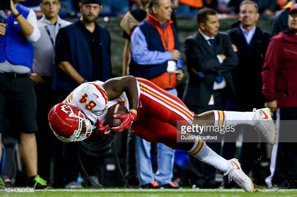 Tight end Demetrius Harris of the Kansas City Chiefs dives forward after a 35 yard first down catch in the fourth quarter of a game against the...