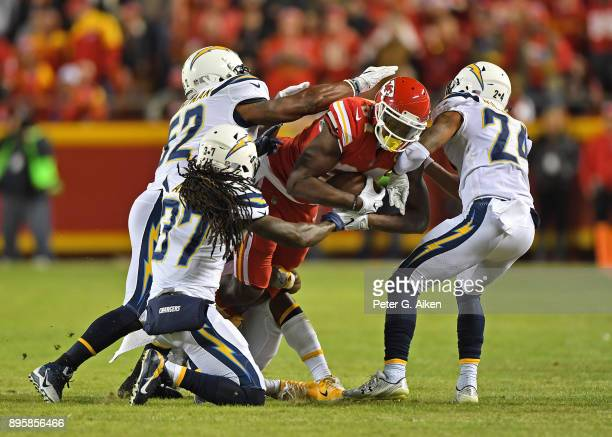 Tight end Demetrius Harris of the Kansas City Chiefs gets gang tackled by inside linebacker Denzel Perryman strong safety Jahleel Addae and...