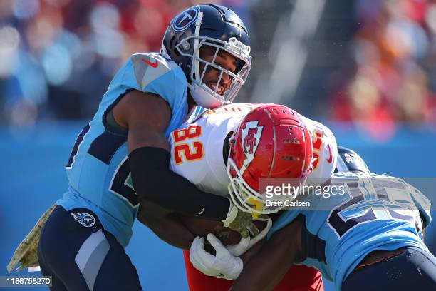 Tight end Deon Yelder of the Kansas City Chiefs is stopped by cornerback Logan Ryan and cornerback Adoree' Jackson of the Tennessee Titans in the...