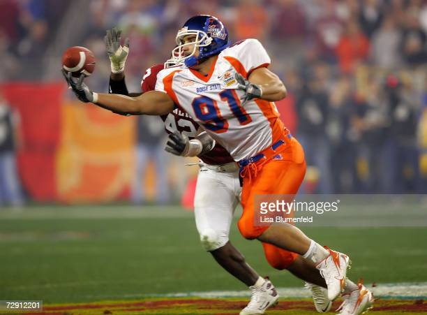 Tight end Derek Schouman of the Boise State Broncos tries to catch the ball with one hand as he is covered by linebacker Rufus Alexander of the...