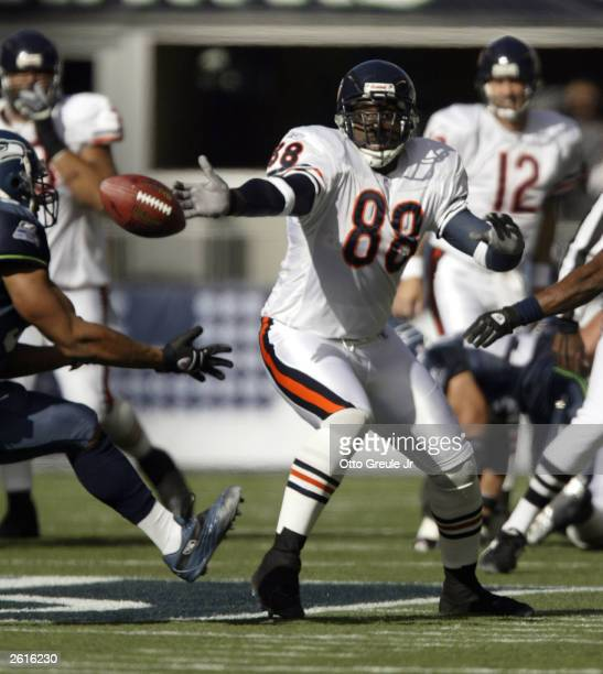 Tight End Desmond Clark of the Chicago Bears reaches for the ball as it is intercepted by Anthony Simmons of the Seattle Seahawks on October19, 2003...